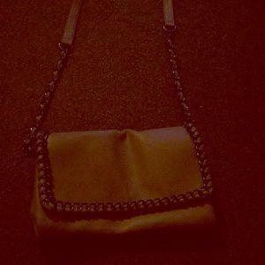 A beige hand side purse, it has 2 pockets,